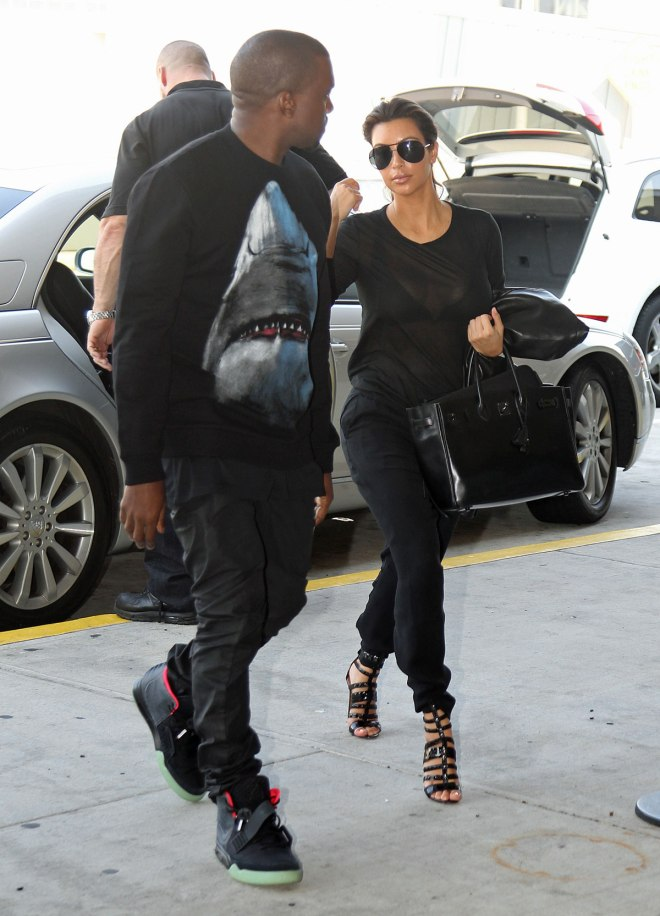 KIM KARDASHIAN and Kanye west at JFK Airport